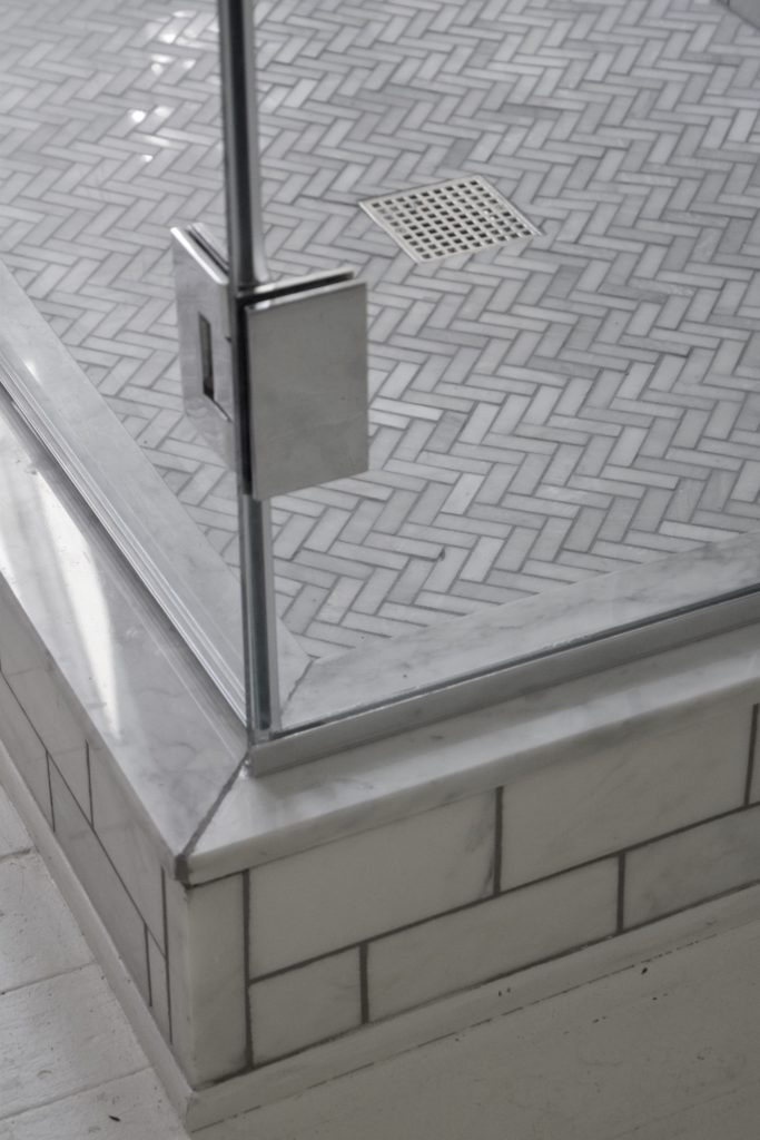 herringbone carrara tile shower floor