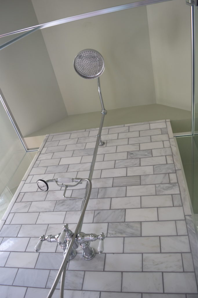 vintage rain shower head carrara marble subway tile