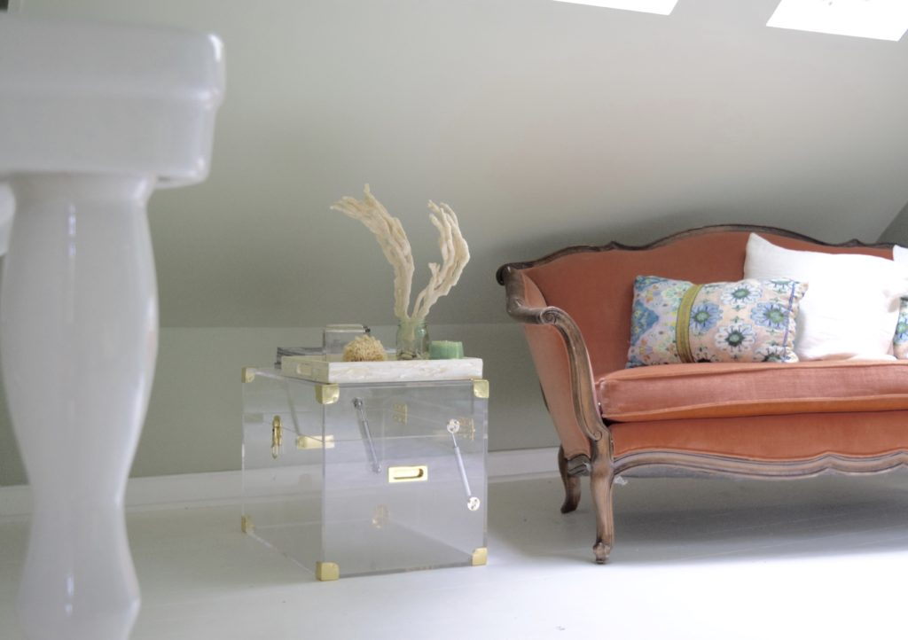 lucite chest peach settee couch in bathroom
