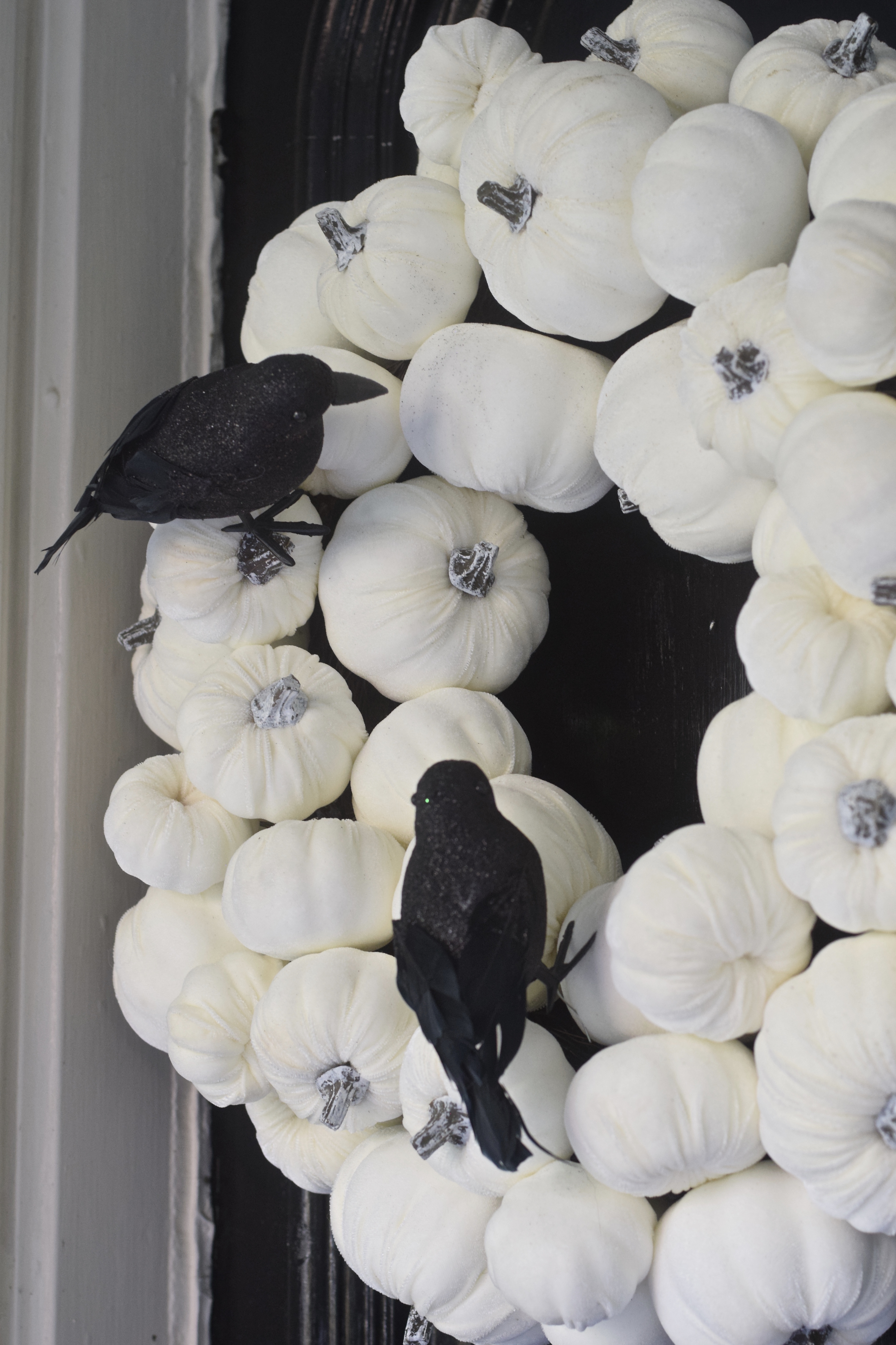 white pumpkin wreath with crows