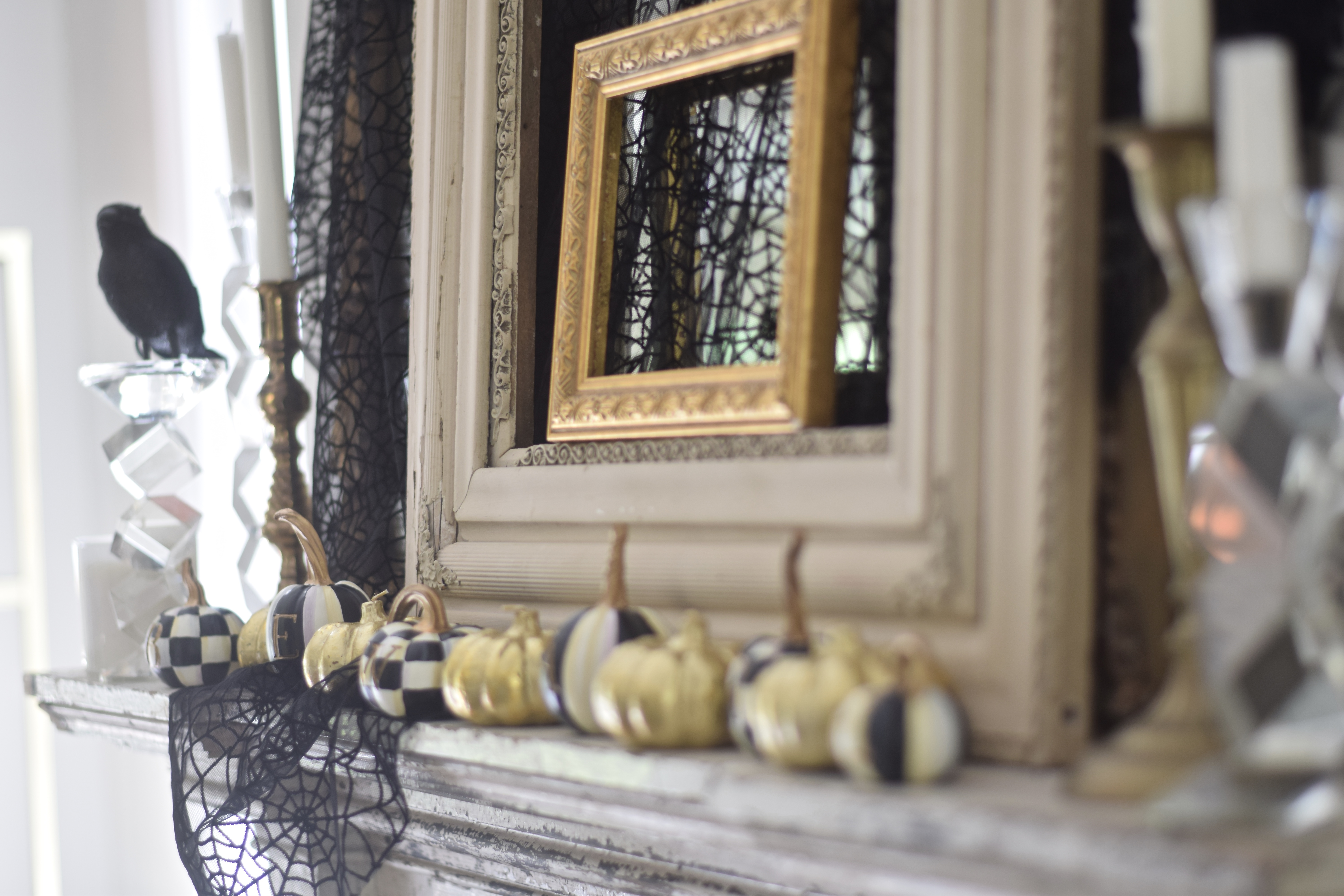 glam halloween mantel with mini gold pumpkins