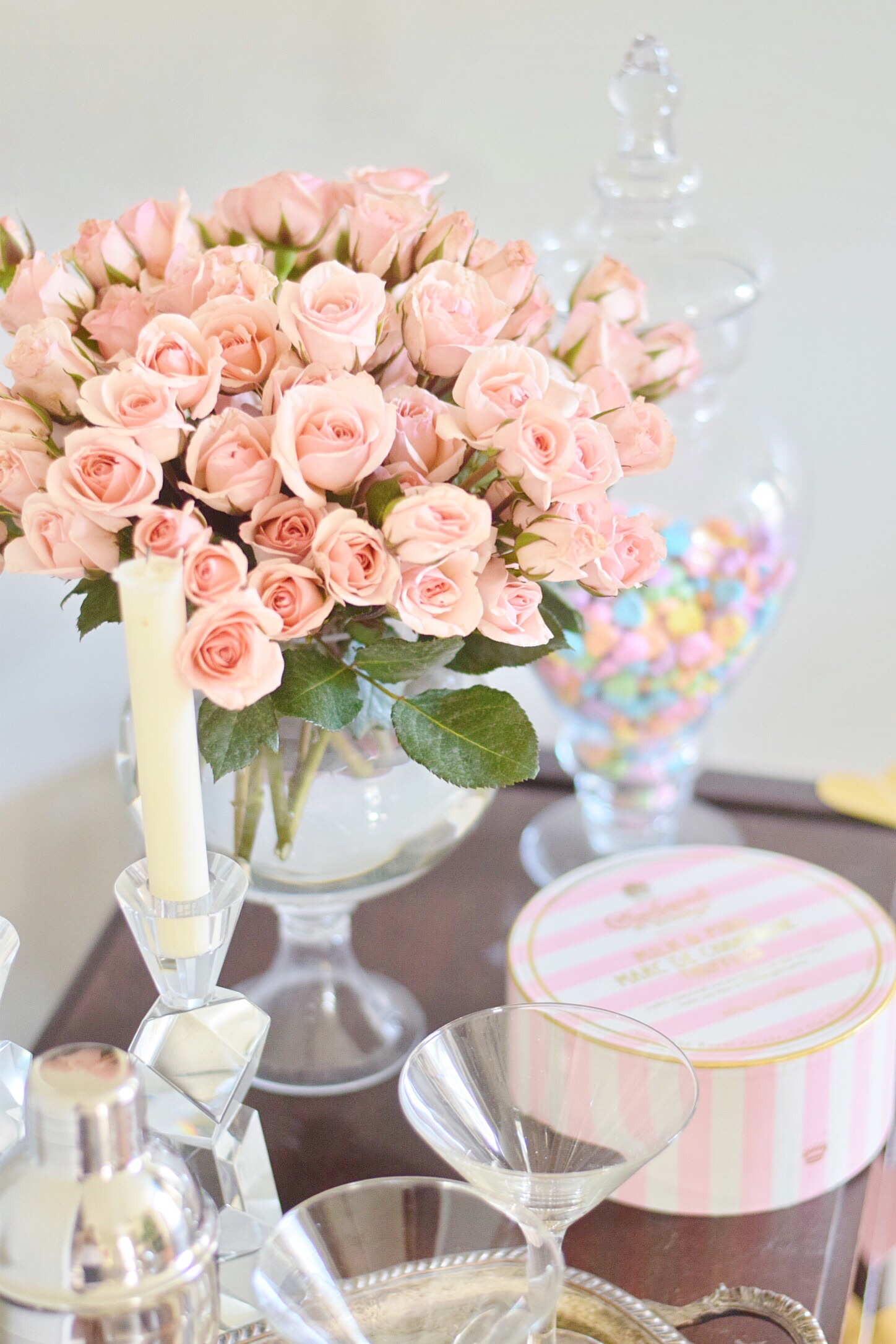 candy pink roses on bar cart